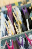stock photo of peg  - Detail of pegs and many colorful clothes - JPG