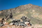 stock photo of jabal  - Ruins of a wall in the mountains, Jabal Shams, Oman
