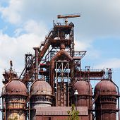 foto of blast-furnace  - building a blast furnace at the steel industry on a background of blue sky - JPG