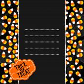 stock photo of centerpiece  - Halloween candy with halloween retro shaped sticker on dark vertical seamless torn centerpiece with blank place for your text - JPG