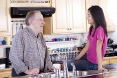 picture of mixing faucet  - Old man and granddaughter talking in the kitchen - JPG