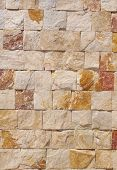 picture of gneiss  - Wall lined with colorful gneiss slabs in sunny day - JPG