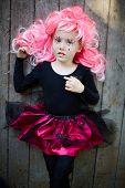 image of antichrist  - Calm Halloween girl with pink hair looking at camera - JPG