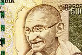 picture of gandhi  - Closeup macro view of Mahatma Gandhi on an Indian currency note - JPG