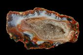 foto of agate  - A cross section of Agat stone with geode on a black background  - JPG