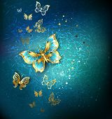 picture of brooch  - Luxury gold butterflies on blue textural background - JPG