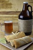 stock photo of growler  - Microbrew Beer and plate of traditional tamales - JPG