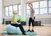 picture of physical therapist  - Physical therapist instructing a senior woman at rehab - JPG
