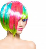 stock photo of colore  - Beauty Fashion Model Girl with Colorful Dyed Hair - JPG