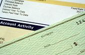 stock photo of lien  - This is an image of a mortgage statement and personal check - JPG