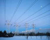 picture of electricity pylon  - Electricity pylons and power high voltage power tower in winter evening - JPG