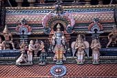 stock photo of meenakshi  - Stucco sculptures on a tower of Meenakshi Temple Madurai - JPG