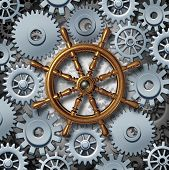 picture of steers  - Business navigation concept as a marine boat steering wheel connected to gears and cog wheels as a metaphor for financial corporate management and career direction - JPG
