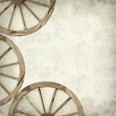 picture of wagon  - textured old paper background with old wagon wheel - JPG