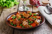 pic of pea  - beef stew with peas and carrots on a plate - JPG
