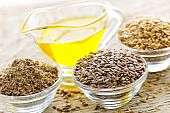 stock photo of flax seed oil  - Bowls of whole and ground flax seed with linseed oil