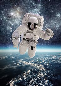 stock photo of spaceman  - Astronaut in outer space against the backdrop of the planet earth - JPG