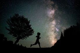 image of boys night out  - Happy child running silhouette with Milky Way and beautiful night sky full of stars in background - JPG
