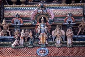 stock photo of meenakshi  - Stucco sculptures on a tower of Meenakshi Temple Madurai - JPG