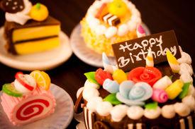 stock photo of happy birthday  - Four sweet birthday cakes - JPG