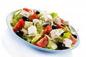 stock photo of greeks  - Greek salad on white background - JPG