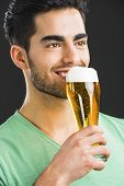 image of draft  - Portrait of handsome young man tasting a draft beer - JPG