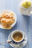picture of jug  - Cup of black coffee with milk on wooden board with croissants and jug - JPG