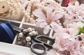 stock photo of mother-of-pearl  - embroidery vintage  accessories with fresh flowers and pearls  - JPG