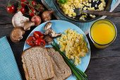 foto of scrambled eggs  - serving healthy brunch scrambled egg with vegetables from above - JPG
