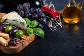 stock photo of cheese platter  - Food backgroundrustic board with cheese herbs and wine - JPG