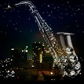 stock photo of saxophones  - abstract night sunset background with city and saxophone - JPG