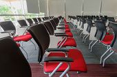 stock photo of training room  - Many red chairs arranged neatly in a training room - JPG