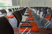 foto of training room  - Many dark yellow chairs arranged neatly in a training room - JPG