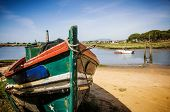pic of forlorn  - The remains of an old fishing boat rotting on the river shore - JPG