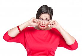 stock photo of cry  - Crying beautiful plus size woman in red dress isolated on white background - JPG