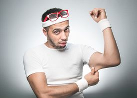 image of nerds  - Funny man testing the flabby muscle under her arm  - JPG