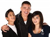 stock photo of threesome  - Smiling Hispanic father with happy children on white background - JPG