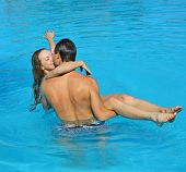 picture of kissing couple  - couple in a pool - JPG