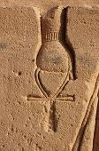 foto of ankh  - Detail of a carving of an ancient egyptian goddess holdingan ankh - JPG