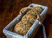 Wicker Basket With Bread. Bread And Buns Inside Basket. Fresh Bakery Products On Table. Tastes Best  poster
