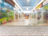 Marble Board Empty Table In Front Of Blurred Background. Perspective Table Over Blur In Shopping Mal poster