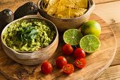 Guacamole Dip In Bowl With Tortilla Chips And Ingredients poster