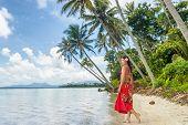 Tahiti luxury travel beach vacation woman walking in polynesian cover-up skirt beachwear on idyllic  poster
