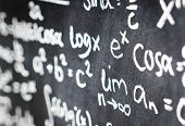 Close Up Of Blackboard Full Of Math Equation, Formula And Numbers. Chalkboard In Math Or Science Cla poster