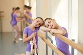 Teen Ballerina In Ballet Class. A Ballet Dancer Resting Her Head On Her Arms At The Barre In A Balle poster
