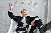 Concept Very Wealthy Businessman. Businessman Is Happy With His Money.a Businessman Showing His Mone poster