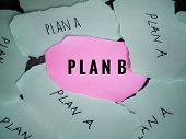 Planning Concept. Plan A And Plan B Written On Ripped Papers. Plan B Written On Pink Paper Which Is  poster