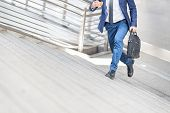 Businessman Is Running Up The Stair.confident And Active Businesspersons Creative Business  Work Out poster