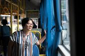Asian Woman 40s People Travel By Passenger Bus In Bangkok City. Buses Are One Of The Most Important  poster