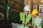 Asian Female Engineer Factory Inspection With Man Business Holding Tablet Engineer In Industry We We poster